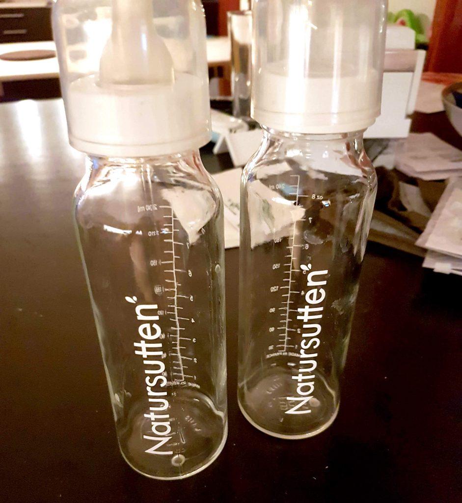 bebisprylar nappflaskor i glas